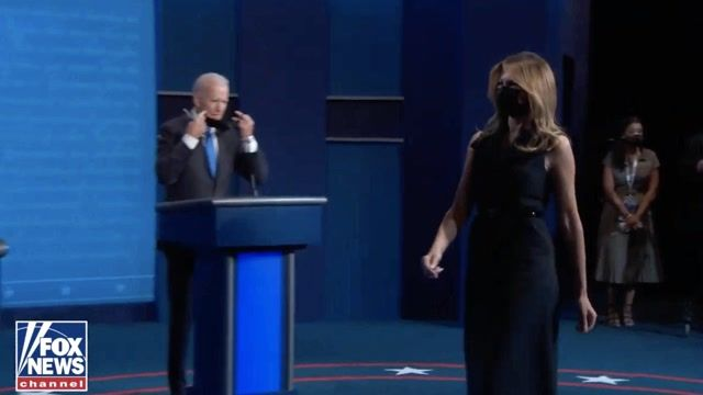 The first lady and Dr. Biden come on to the stage at the end of the final presidential debate.