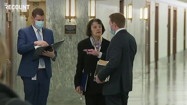Sen. Dianne Feinstein (D-CA), without a mask, walks through the corridor before today's Facebook/Twitter CEO hearing.
